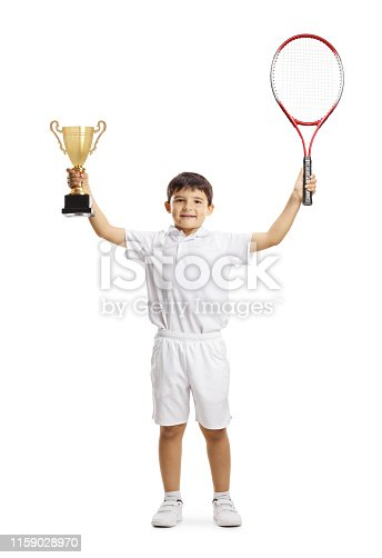 Full length portait of a happy boy winner in junior tennis with a trophy cup isolated on white background