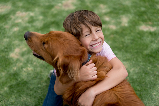 Happy boy with a beautiful dog
