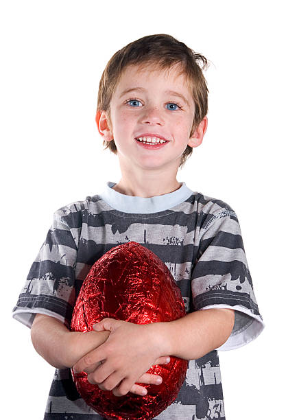 Happy Boy with a Big Easter Egg stock photo