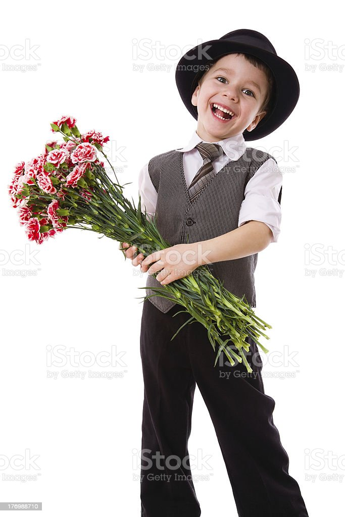 Happy boy with a bouquet of carnations royalty-free stock photo