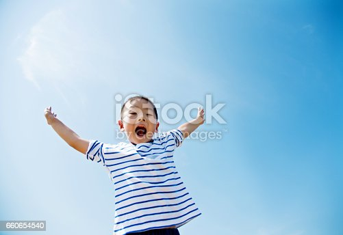 Happy boy with arms outstretched
