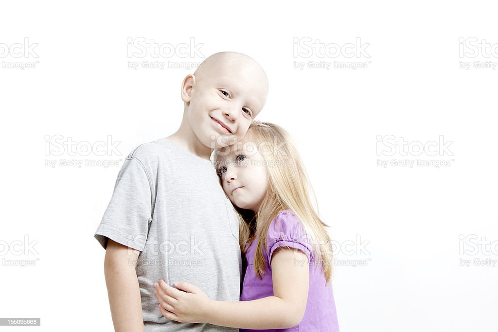 Happy Boy with Cancer and Loving Sister Horizontal stock photo
