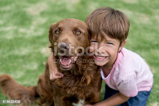 istock Happy boy with his adopted dog 618635408