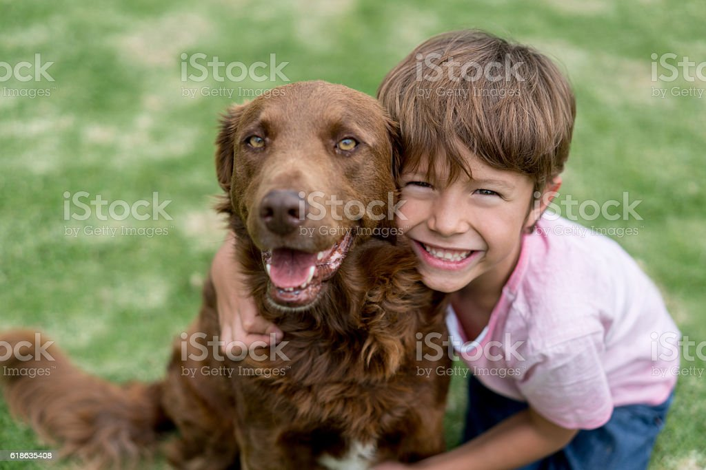 Happy boy with his adopted dog stock photo