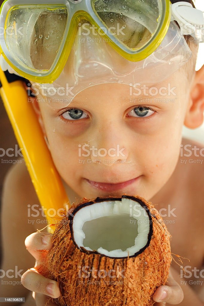 Happy boy with the coconut stock photo