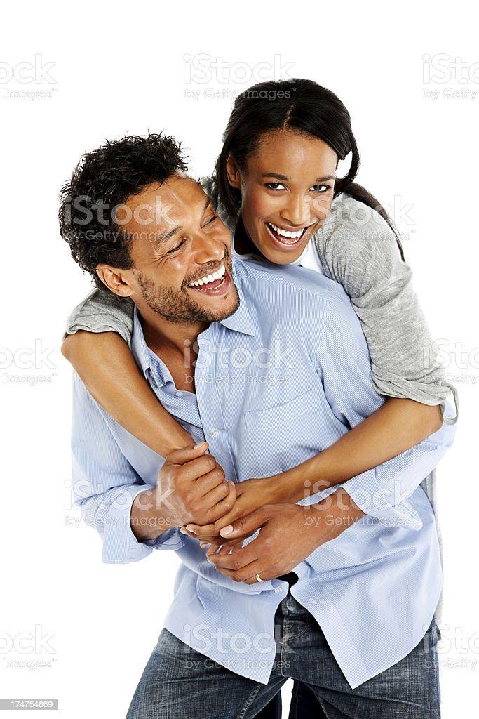 Happy boyfriend piggybacking his girlfriend royalty-free stock photo