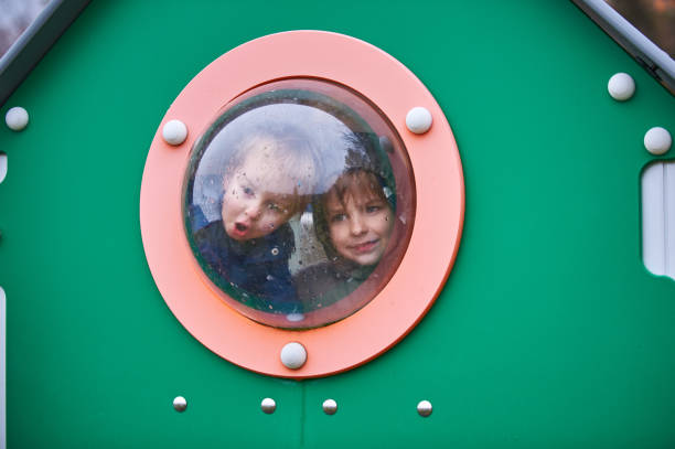 Happy boys playing at the playground. stock photo