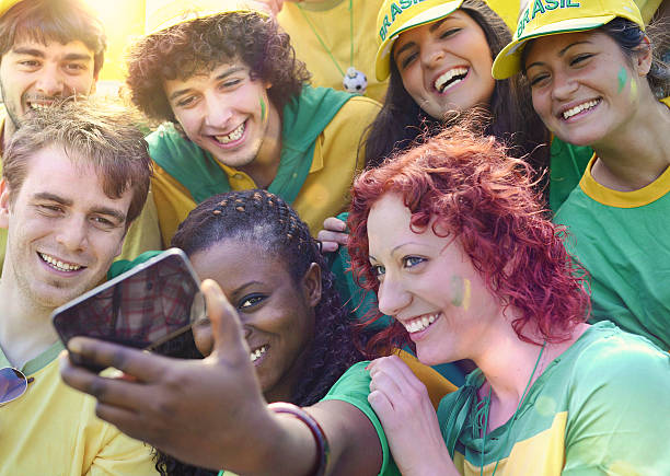 Happy Brasilian supporters Taking a Photo with Mobile Phone stock photo