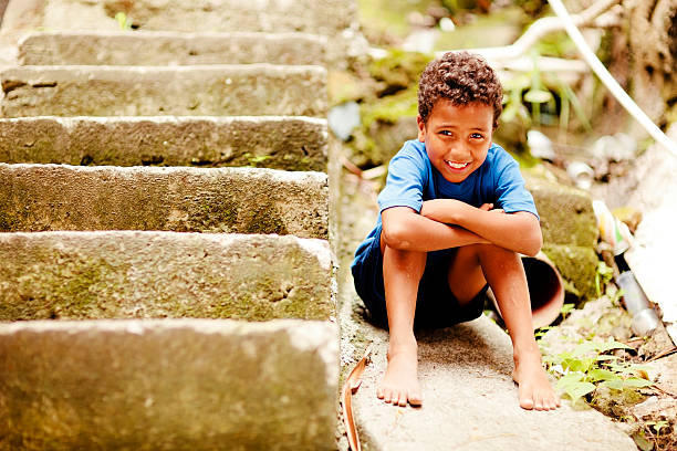 Happy Brazilian Boy A young boy from a favela in Rio de Janeiro, Brazil is a happy boy, despite poverty. illiteracy stock pictures, royalty-free photos & images