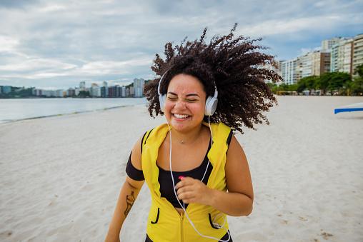 Shot of young brazilian woman running outdoors