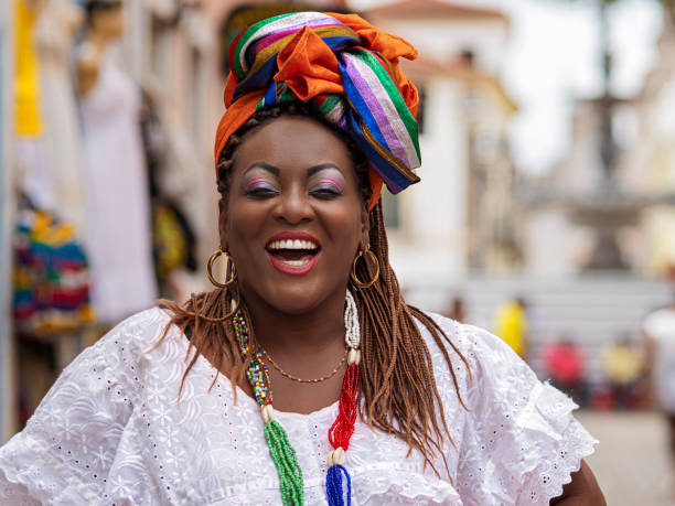 Happy Brazilian Woman of African Descent Dressed in Traditional Baiana Costumes, Salvador da Bahia, Brazil stock photo