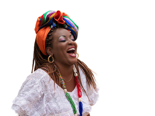 Happy Brazilian Woman of African Descent Dressed in Traditional Baiana Costumes on White Background, Salvador da Bahia, Brazil stock photo