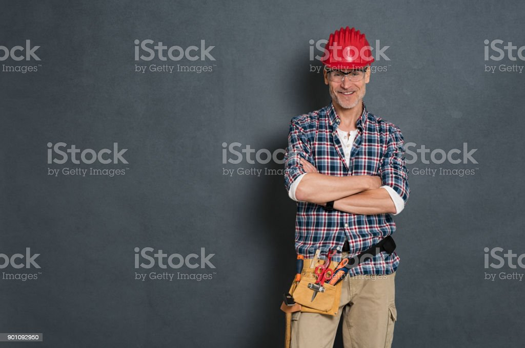 Happy bricklayer ready to work stock photo