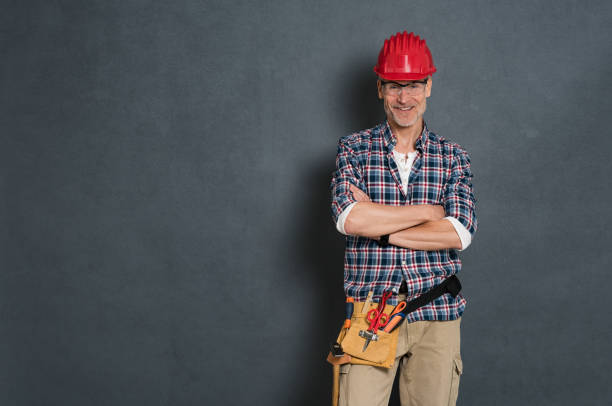 Happy bricklayer ready to work stock photo