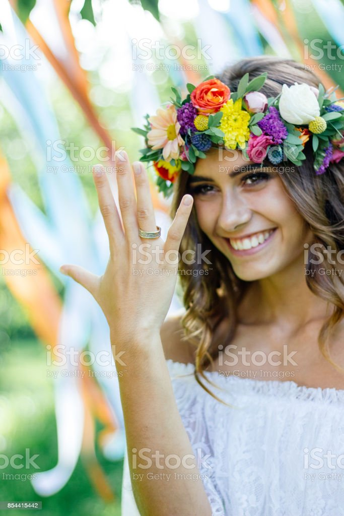 Happy bride after wedding ceremony showing fingers with wedding ring and smiling. stock photo