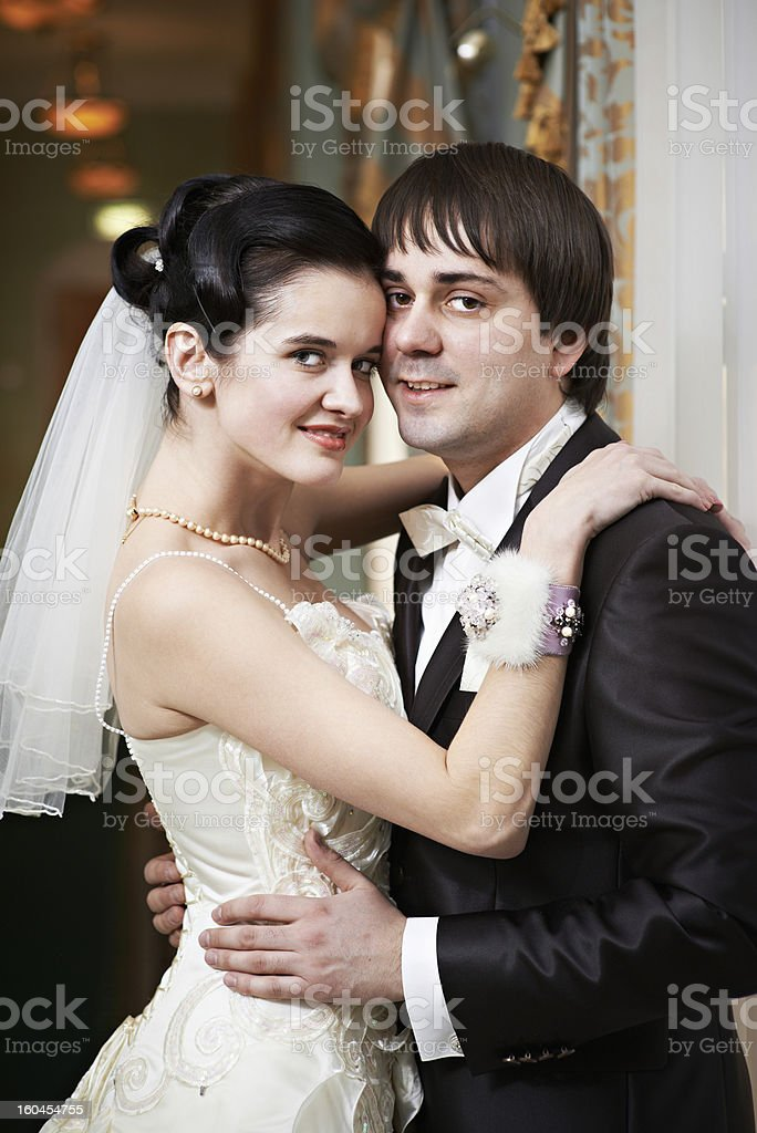 Happy bride and groom embrace royalty-free stock photo
