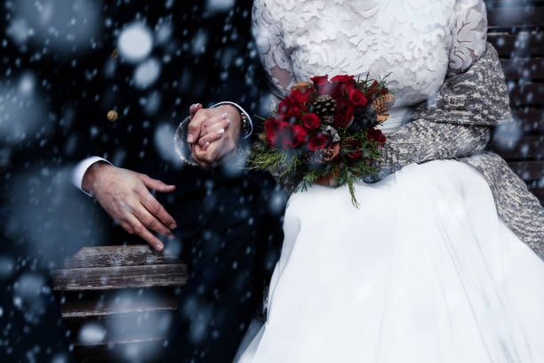 Happy bride and groom enjoying romantic moments outdoors. Wedding couple.Winter concept. stock photo