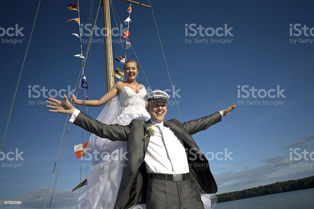 Happy bride and groom flying with open arms royalty-free stock photo