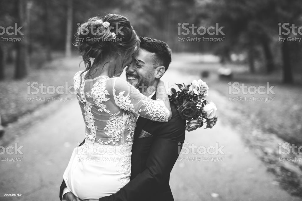 Happy bride and groom in black and white stock photo