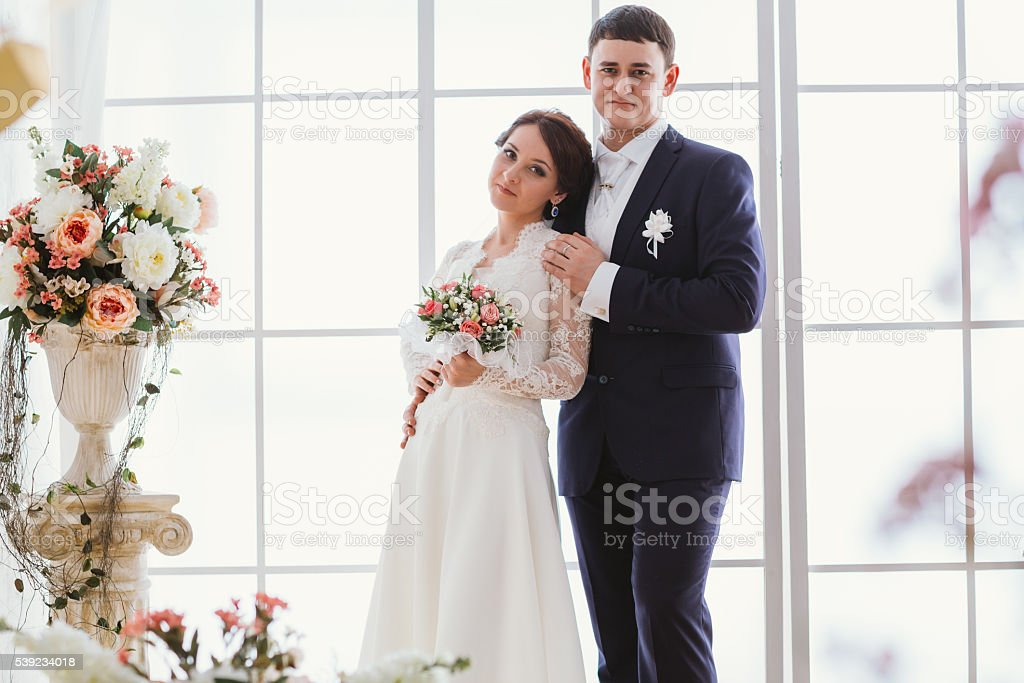 Happy bride and groom in  studio royalty-free stock photo