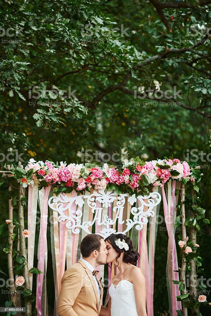 happy bride and groom in the autumn forest stock photo