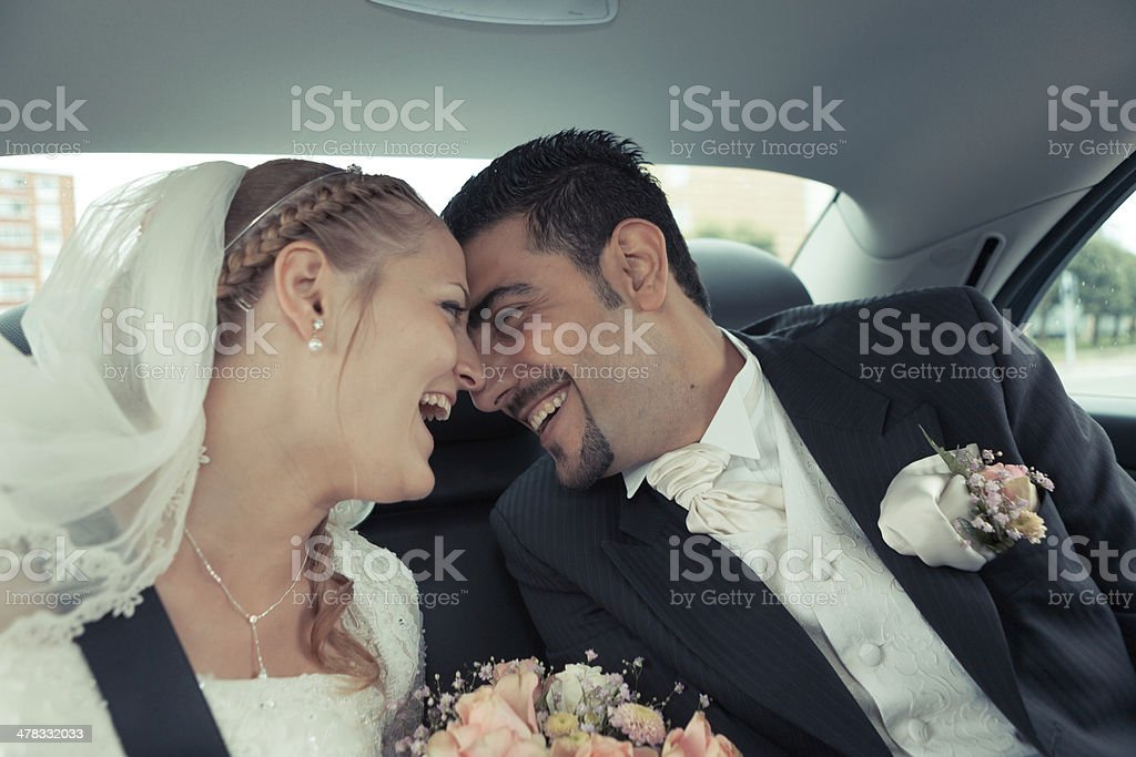 Happy bride and groom kissing stock photo