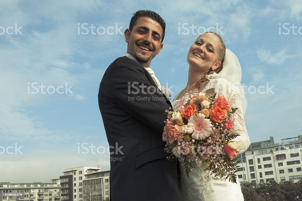 Happy bride and groom Lokking at camera smiling stock photo