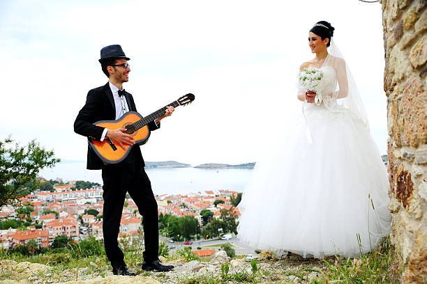 Happy bride and groom Serenade a beautiful on Bride Groom. serenading stock pictures, royalty-free photos & images