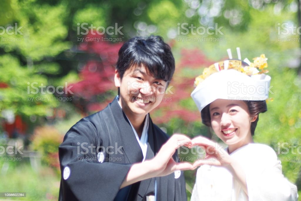 Traditional Japanese Wedding.Happy Bride And Groom Wearing A Kimono At A Traditional Japanese