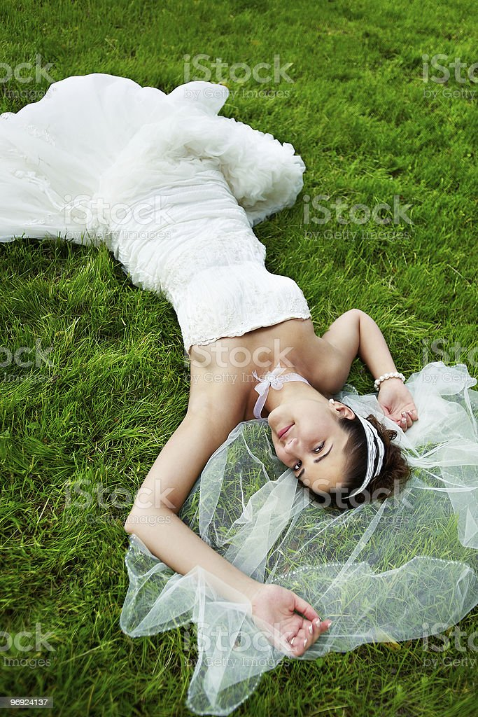 Happy bride are on grass royalty-free stock photo