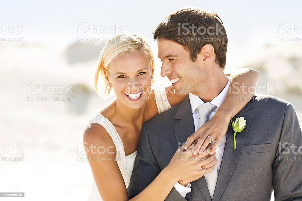 Happy Bride Embracing Groom On Beach royalty-free stock photo