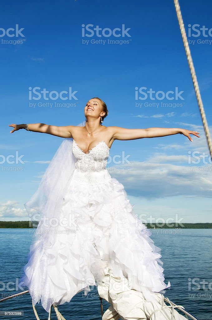 Happy bride flying with open arms royalty-free stock photo