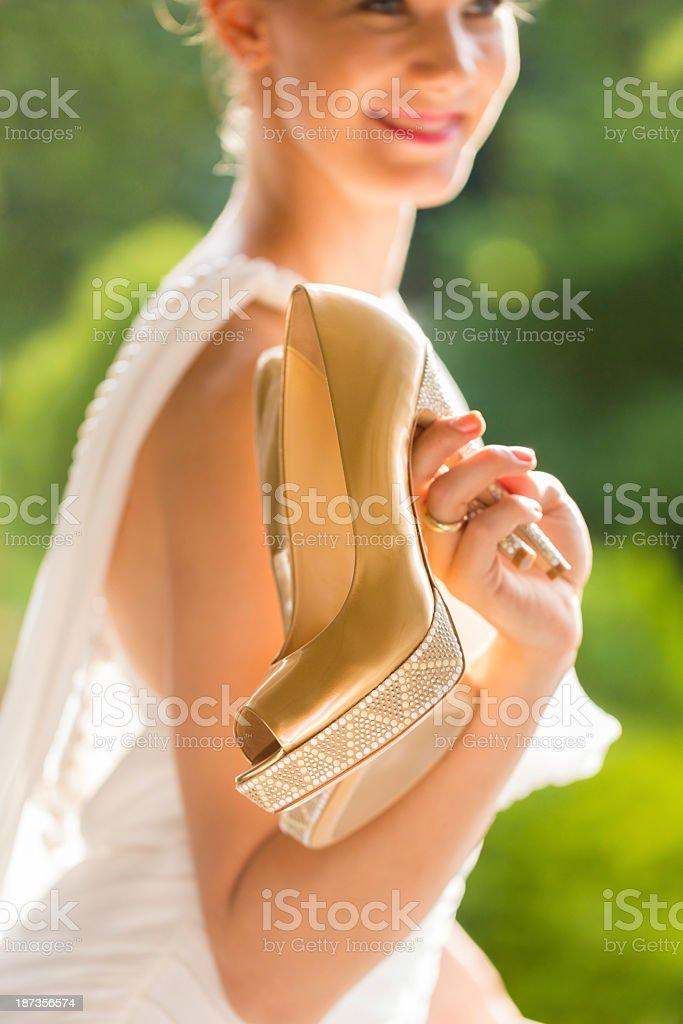 Happy Bride Holding Wedding Shoes royalty-free stock photo