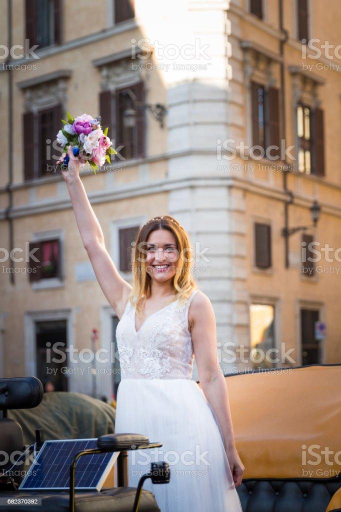 Happy bride in beautiful carriage on wedding walk zbiór zdjęć royalty-free