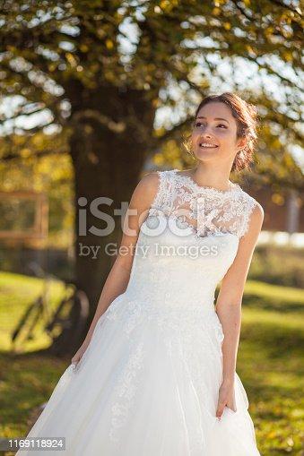 1054970060istockphoto Happy bride in nature 1169118924