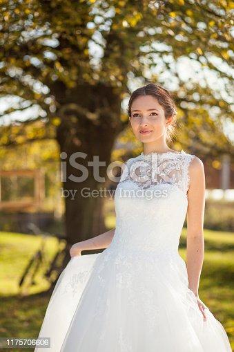 1054970060istockphoto Happy bride in nature 1175706606