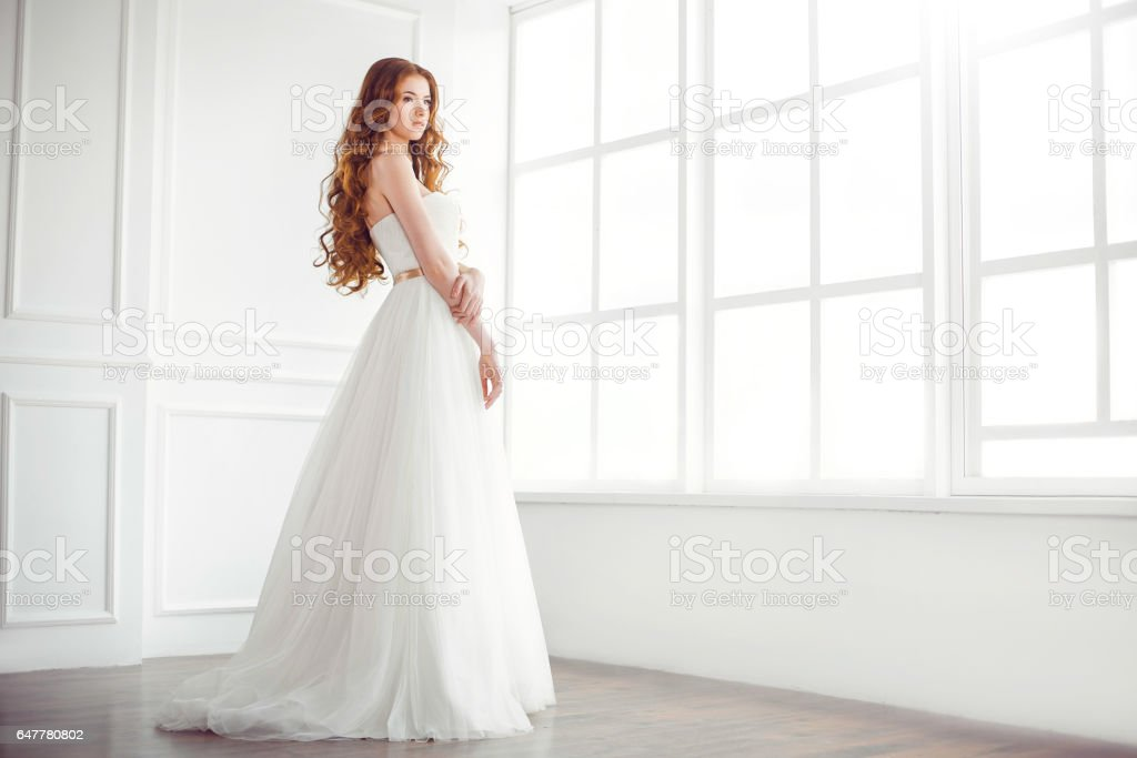 Happy bride indoors stock photo