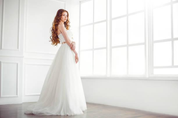 Happy bride indoors stock photo