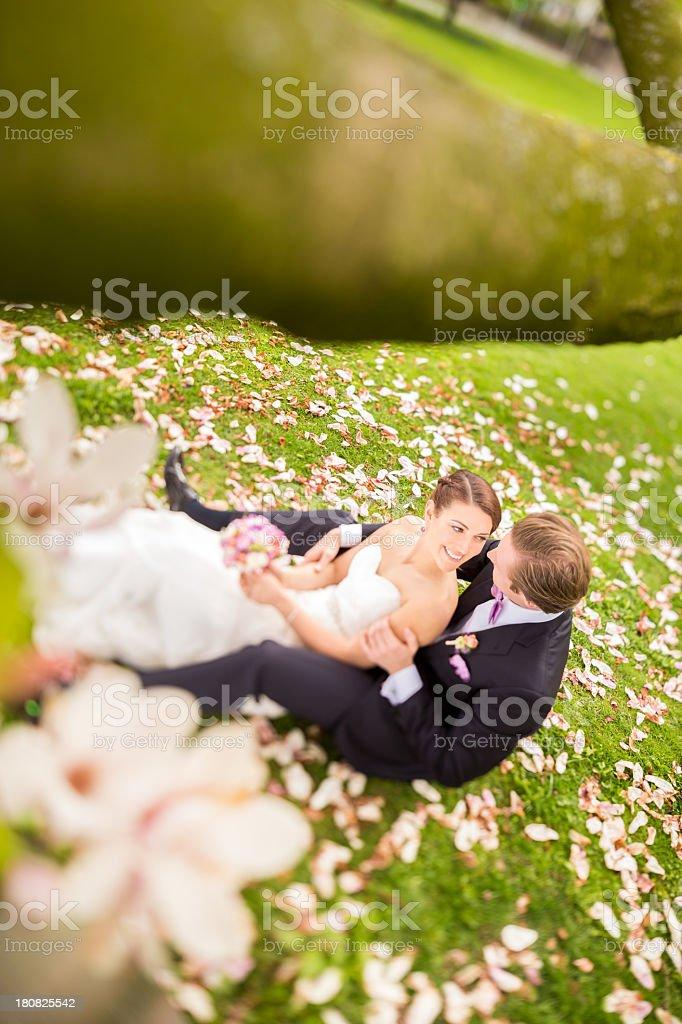 Happy bride looking into groom's eyes royalty-free stock photo