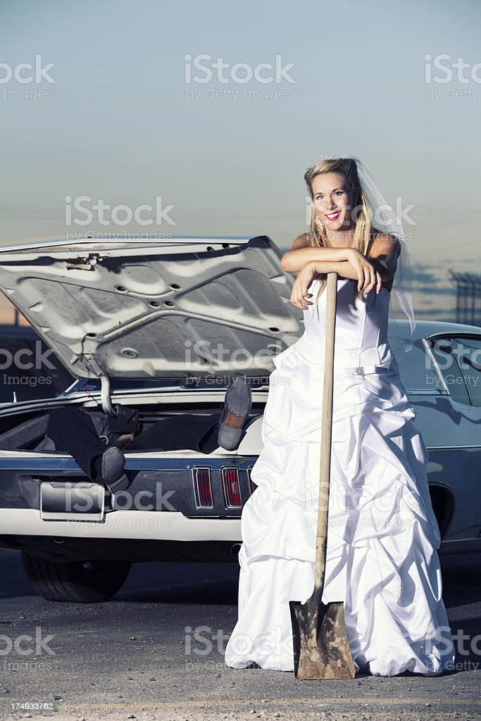Happy bride next to a body man in the trunk royalty-free stock photo