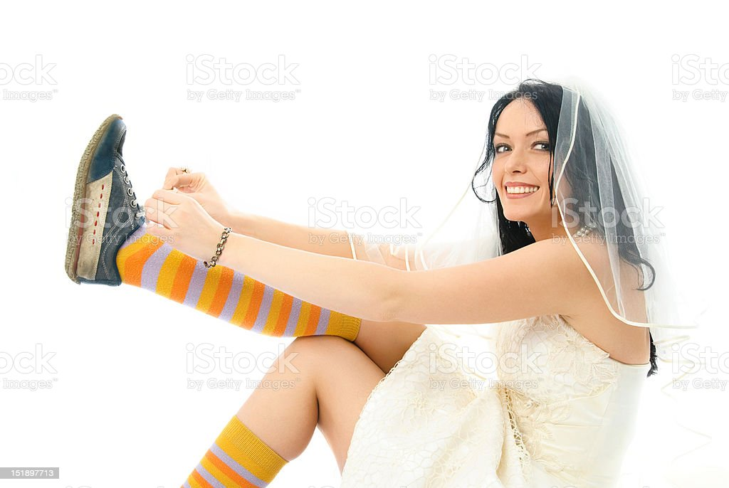 happy bride putting on sporting shoes royalty-free stock photo
