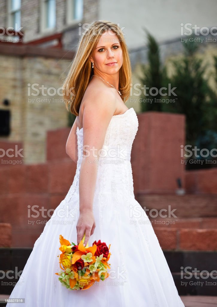 Happy Bride Standing Outdoors stock photo