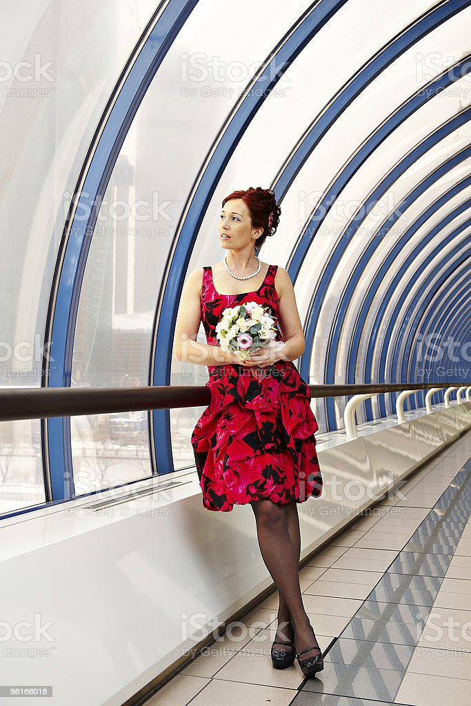 Happy bride with wedding bouquet on bridge royalty-free stock photo