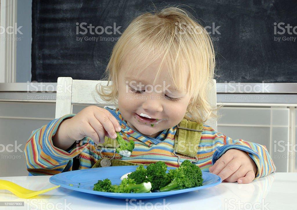 Happy broccoli eater stock photo
