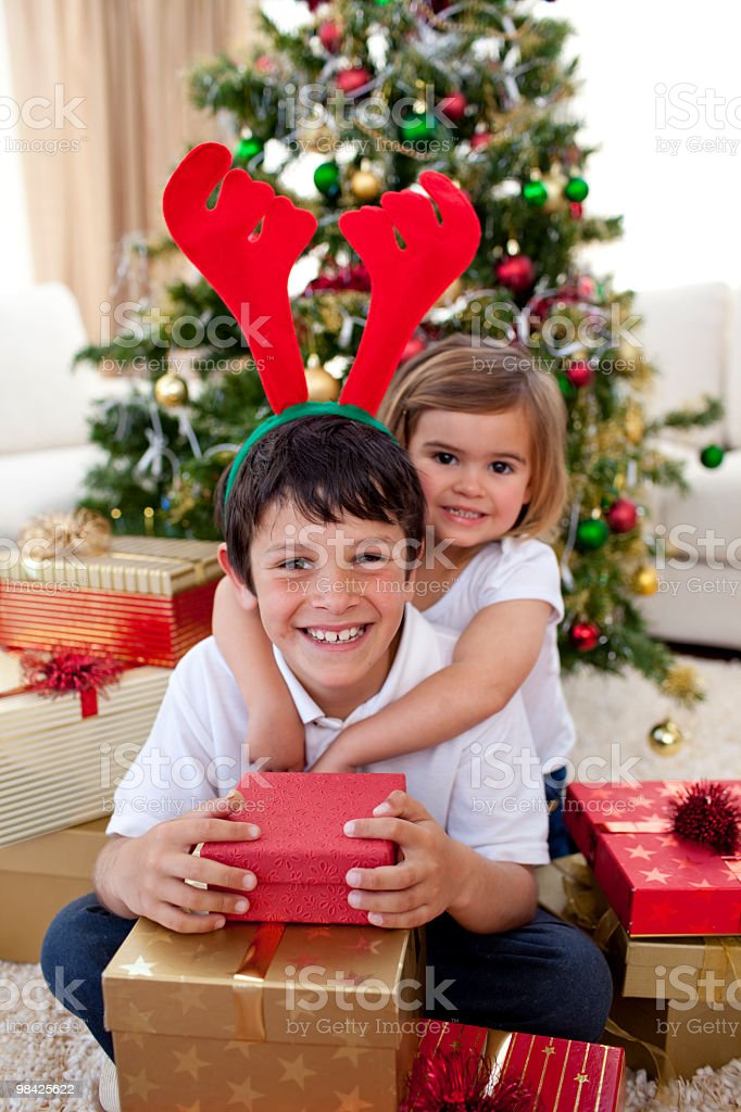 Happy brother and sister celebrating Christmas royalty-free stock photo
