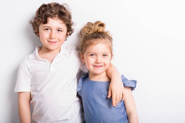 happy brother and sister hugging each other - sister stock photos and pictures