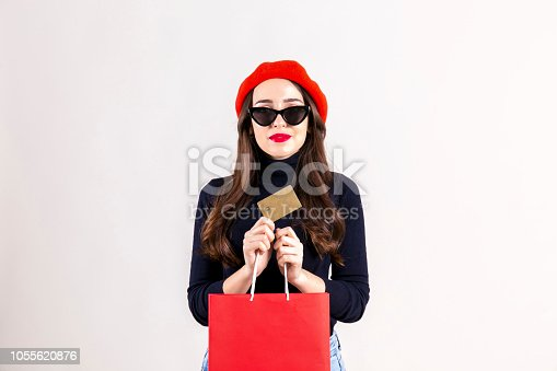 istock Happy brunette female with long hair in casual outfit posing over isolated white background. 1055620876