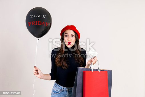 istock Happy brunette female with long hair in casual outfit posing over isolated white background. 1055622548