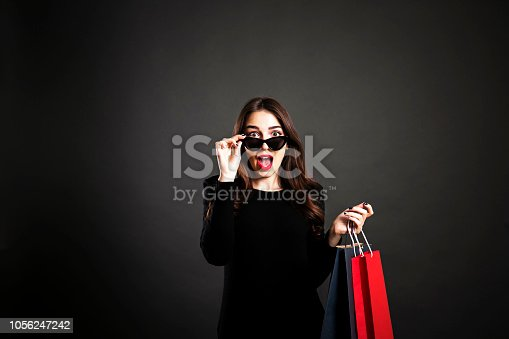 istock Happy brunette female with long hair in casual outfit posing over isolated white background. 1056247242