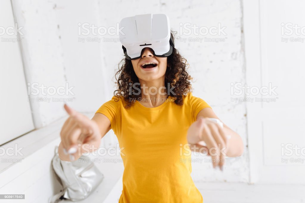 Happy brunette laughing at you stock photo
